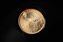 Dollar coins in the crude oil Stock Photos
