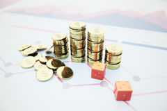 Dollar coins and dice Stock Images