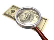 Dollar concept. Dollar banknote lying under magnifying glass Royalty Free Stock Photo