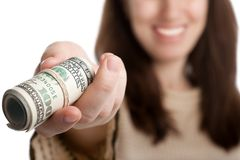 Dollar currency in hand. Women hand holding rolled up paper dollar currency Royalty Free Stock Photos