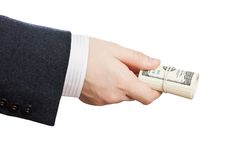 Dollar currency in hand. Business man hand holding rolled up paper dollar currency Stock Photography