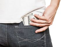 Dollar currency in jeans pocket Royalty Free Stock Image