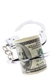 Dollar Currency notes with handcuffs Royalty Free Stock Image