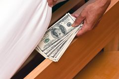 Dollar Currency notes are hidden under the bed Royalty Free Stock Photo