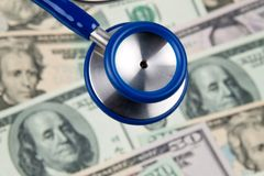 Dollar currency notes and stethoscope Stock Photography