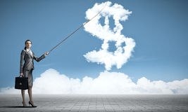 Dollar currency rate. Attractive businesswoman holding on lead cloud dollar currency symbol Stock Photography