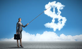 Dollar currency rate. Attractive businesswoman holding on lead cloud dollar currency symbol Stock Photos
