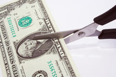 Dollar cut. Cutting you money down to size Royalty Free Stock Images