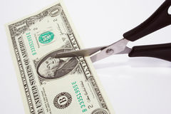 Dollar cutting. Cutting your money down to size stock image