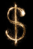 Dollar de cierge magique sur le fond noir Image stock