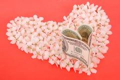 Dollar de coeur sur le coeur fait de fleurs Photo libre de droits