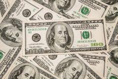 Dollar de devise d'argent - $ 100 comme fond Photographie stock libre de droits