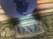 Dollar de globe photographie stock