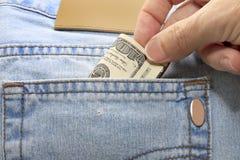 Dollar in der rückseitigen Tasche Stockfoto