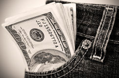 Dollar in der Tasche Stockfotos
