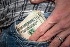 Dollar in der Tasche Stockbilder