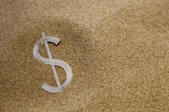 Dollar in desert sand Stock Images