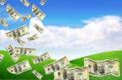 Dollar, die vom Himmel (auserwählter, fallen Fokus) Stockbild