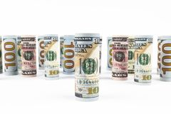Dollar. Dollar banknotes roll in other positions. American US currency on white board. American dollar banknote rolls. In all denominations on white background royalty free stock photography