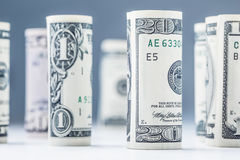 Dollar. Dollar banknotes roll in other positions. American US currency on white board and defocused background Stock Photography