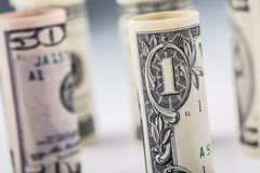 Dollar. Dollar banknotes roll in other positions. American US currency on white board and defocused background Stock Images