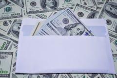 Dollar in einem Umschlag Lizenzfreies Stockbild