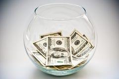 Dollar in einer Flasche Stockfotos