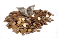 Dollar en muntstukken stock afbeeldingen
