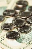 Dollar en muntstukken Stock Foto's
