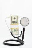 Dollar en stethoscoop Stock Afbeeldingen