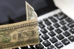 Dollar et clavier Photos stock