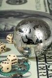 Dollar et globe. Image stock