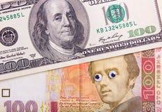 Dollar et hryvnia avec de grands yeux Image libre de droits