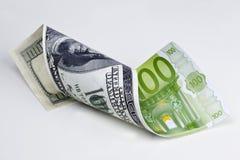 Dollar - Euro. Curled dollar bill transformed to euro bill Royalty Free Stock Photo