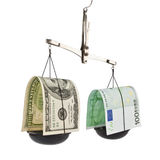 Dollar and the euro in the balance Stock Photography