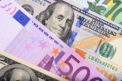 Dollar and euro bank notes on the table Stock Images