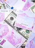 Dollar and euro banknotes Stock Photos