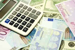 Dollar, euro banknotes, calculator Royalty Free Stock Image