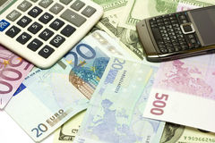 Dollar, euro banknotes, calculator and cellphone Royalty Free Stock Images