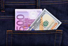 Dollar and euro banknotes in jeans pocket Stock Images