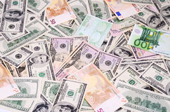 Dollar and euro bills on the full frame Royalty Free Stock Photography