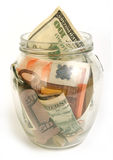 Dollar and euro bills in glass jar royalty free stock photo