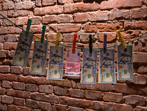 Dollar and euro bills  hanging on a rope Stock Photo
