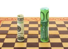 Dollar and euro on chess board Stock Photography