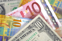 Dollar, euro et franc Photos stock