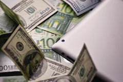 Dollar and euro money, tablet, cell phone close up. Dollar and euro money, tablet, cell phone Stock Images