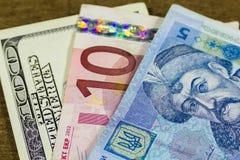 Dollar, euro och hryvnia Fotografering för Bildbyråer