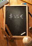 Dollar and euro symbols. Dollar and euro symbol handwritten on a blackboard Royalty Free Stock Photo