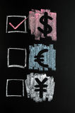 Dollar, Euro and Yuan. Symbols of Dollar, Euro and Yuan drawn with colorful chalk on blackboard Royalty Free Stock Images