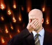 Dollar falling. Businessman suffers from a headache. Dollar falling Royalty Free Stock Image